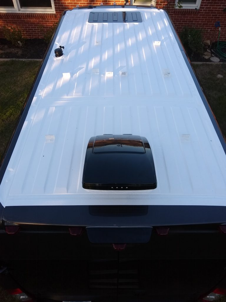 Promaster RV van roof after two coats of Henry Tropi-Cool white roof coating.
