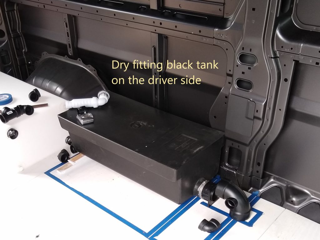 Dry fitting the black tank on our DIY RV camper van wet bath