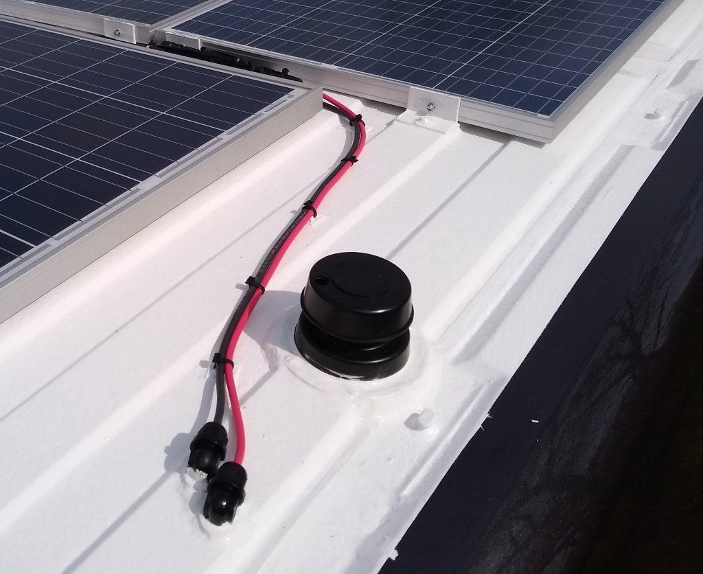 Black tank vent cap on the DIY RV camper van roof
