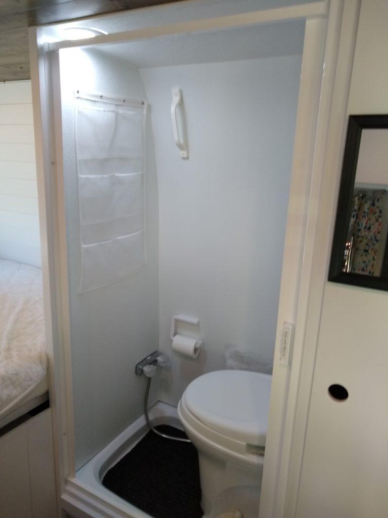 Finished look of our DIY RV camper van wet bath shower