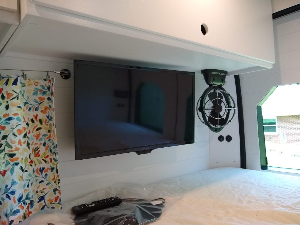 Television over the rear bed, plugs into the galley outlet when used